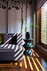 fascinating green house with artistic tree wall mural pretty fascinating green house with artistic tree wall mural pretty indoor plant wood floor cushy purple sofa and nice pillows large glass window