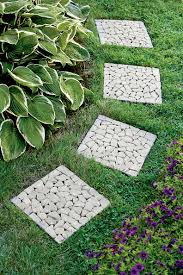 simple cheap garden idea featuring small shrubs garden and mosaic