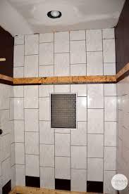 hall bath tile design it s quite the transformation plantation hall bath tile start of shower flip