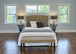 traditional master bedroom with hardwood floors by liz and jan