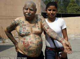 indian man has 366 flag tattoos and all his teeth removed for