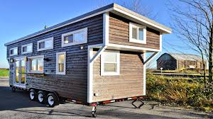 tiny home on wheels custom simple cozy fully equipped kitchen and