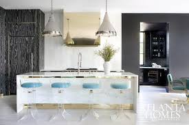 white marble kitchen island white marble waterfall kitchen island with lucite barstools