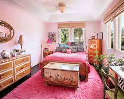 pink bedroom accent wall wide glass window view city lamp desk the
