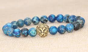 blue stone bracelet images Men 39 s blue sea sediment jasper stone gold lion bracelet 8 in long jpg