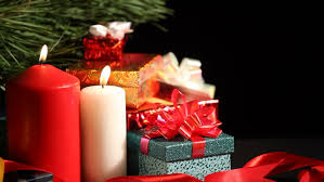 christmas gifts laid on a decorated wicker basket that spins in