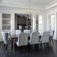Gray Dining Room Features A Tray Ceiling Accented With A Satin - Grey dining room chairs