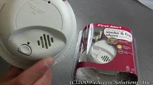smoke detector flashing green light first alert hardwired smoke and fire alarm explanation and un boxing