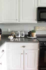 white dove or simply white for kitchen cabinets painted kitchen cabinets 2 years later the turquoise home