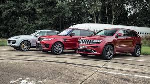 trailhawk jeep srt range rover svr vs jeep grand cherokee srt vs porsche cayenne