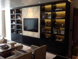 cool wall mounted hidden tv cabinet with awesome book shelf and