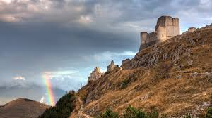rainbow over the old castle on the mountain wallpaper by