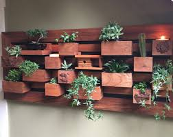 this outdoor or indoor succulent framed wall planter can hold up