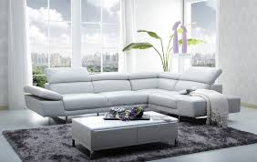 modern living room with l shaped white leather couch built in