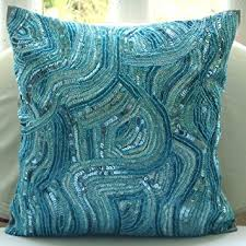 blue accent pillows sequins and beaded abstract