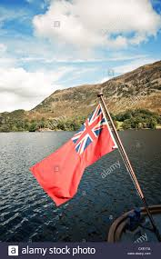 a british flag on the back of a boat stock photo royalty free