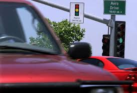 red light camera settlement after legal settlement redflex s six month losses jump by nearly