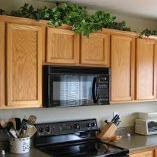 top of kitchen cabinet greenery do it yourself decorations hogado 84
