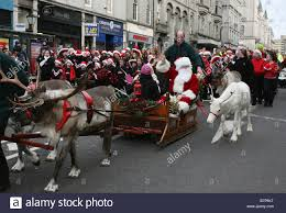 santa claus and his reindeer parade along union street in aberdeen