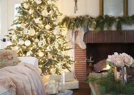 living room christmas tree decorated in blue and silver stone