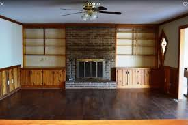 update wood paneling painting wood paneling shelves and updating old fireplace