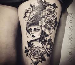 traditional flowers woman tattoo by miss voodoo tattoo woman