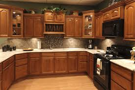 kitchen colors with oak cabinets and black countertops tray