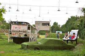 bench berlin oversized benches and cars covered in grass at arena berlin