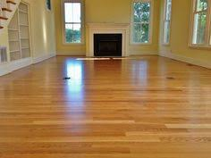 white oak hardwood floor with custom walnut border inlay