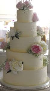 contemporary five tier wedding cake decorated with textured