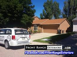 painting contractors colorado springs stucco over siding front