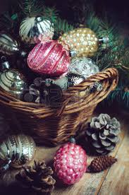 vintage christmas decorations in a wicker basket christmas gift