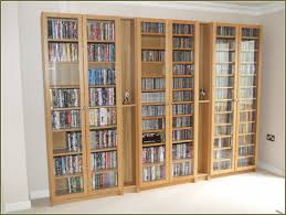 Cd Storage Cabinet With Glass Doors Cd Storage Cabinet In Gracious Oak Storage Cabinet Sauder