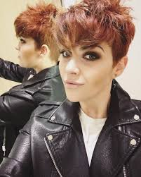 coloring pixie haircut long messy pixie cut with undercut and vibrant cinnamon coloring