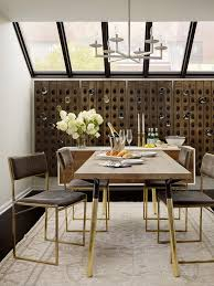 transitional dining room with modern pottery barn wine rack