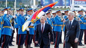 vladimir putin military serbia salutes putin with military parade