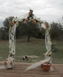 wedding arches decorated with tulle tulle decorated wedding arch also with purple and green
