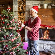 man making the christmas tree in the living room stock photo