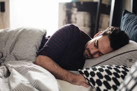 Man Sleeping In Bed Man Sleeping In Bed At Night