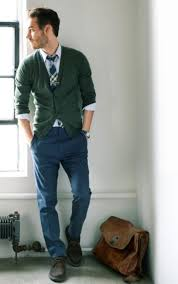 picture of green cardigan a white shirt and a plaid tie