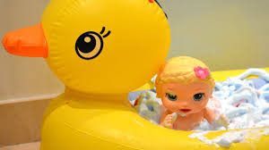 my baby alive doll taking shower in a duck bathtub with baby born