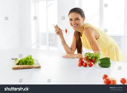 modern vegetarian kitchen healthy diet beautiful smiling woman eating stock photo 341430071