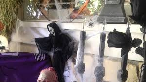 Outdoor Halloween Decor by A Zombie With Black Coat Also White Spider Web Around Feat Spider