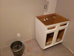 how to fix kitchen base cabinets to wall walls out of square how to align base cabinet home