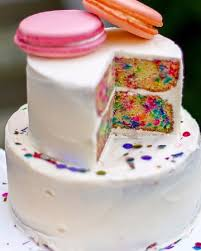 giant wedding cakes confetti wedding cake with giant macarons picture of heritage