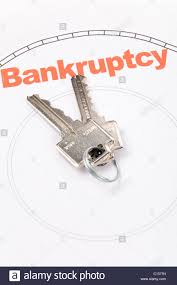 home key and bankruptcy real estate marketing concept stock photo