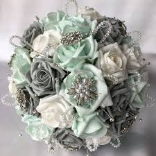 mint flowers brides posy mint grey white roses diamantes brooches