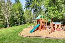 kids outdoor recreation playground with slide swing and playhouse