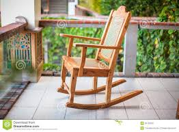 Outdoor Wooden Rocking Chairs For Sale Wooden Rocking Chair On The Terrace Of An Exotic Royalty Free