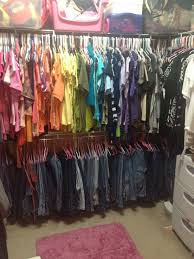 closet organization jeans are hung on baby hangers on a lower